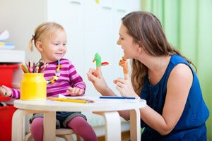 Daycare worker entertaining child - Career opportunities at First Path Day Care Center